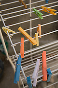 clothes pegs on a drying rack