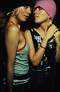 Two female clubbers, one wearing purple hat, Le Batoter Paris, France, 2000.