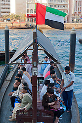 Abra water taxi and passengers  on the Creek in Old Dubai in United Arab Emirates