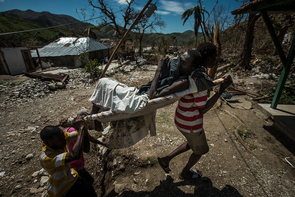 RENDEL, HAITI - OCTOBER 12, 2016: Villagers carry Frisnel Louis on a stretcher to the small clinic in Rendel, because he was too weak to walk, and exhibiting symptoms of Cholera.  For days, aid groups and officials have warned of a coming Cholera outbreak that could affect as many as 500,000 Haitians.  The town of Rendel and its surroundings, which once sheltered 25,000 people, is an epicenter of the coming disaster. PHOTO: Meridith Kohut for The New York Times