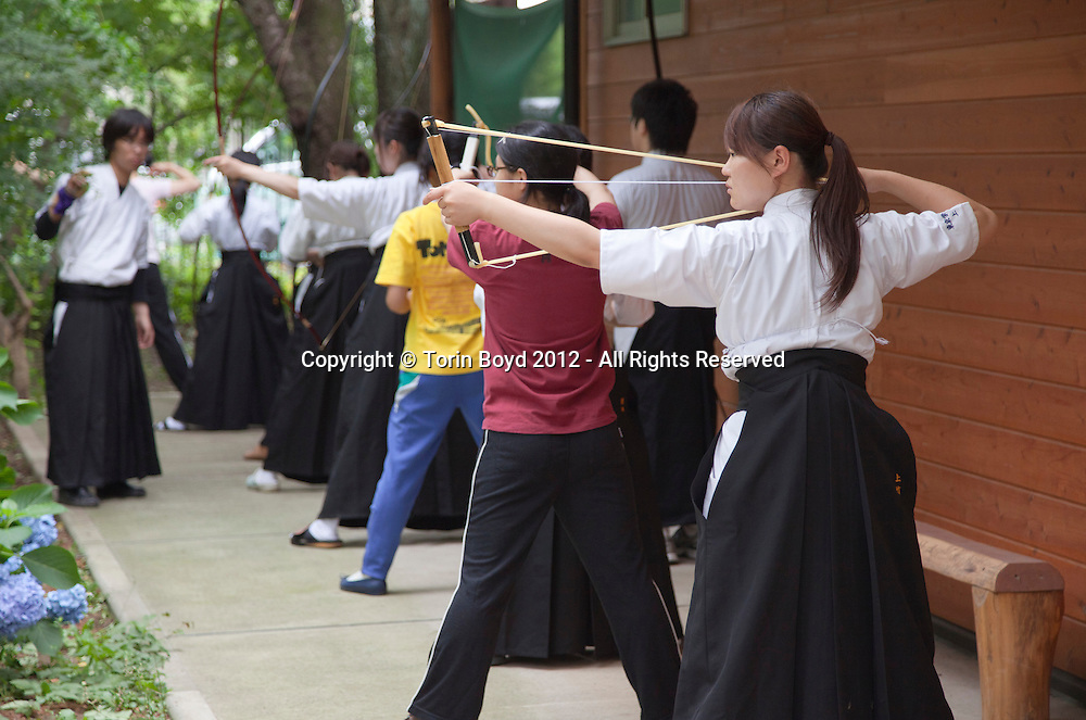 These are students of Tokyo Gakugei University, also known as Gakudai for short, practicing traditional Japanese archery called kyudo. This national university in Koganei City, Tokyo is best known for its education related fields and teacher education. It can trace it's history back to 1873, but was formally chartered as a university in 1949.  Photo taken June 20, 2012 by Torin Boyd.