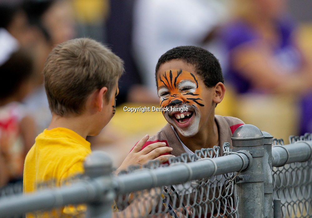 18 April 2009: A LSU fan watches by a fence during the 2009 LSU spring football game at Tiger Stadium in Baton Rouge, LA.