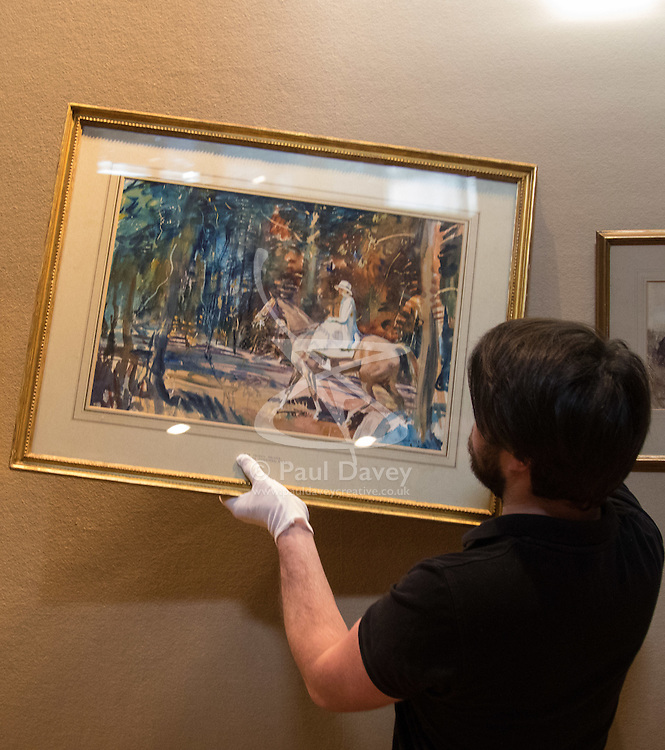 "Bonhams, Mayfair, London, February 26th 2016. A gallery technician hangs ""Portrait of Mrs Abigail Prince"" by Sir Alfred Munnings estimated to fetch between £40-60,000 at the Bonhams 19th Century Art Sale in Mayfair, London on March 2nd 2016. ///FOR LICENCING CONTACT: paul@pauldaveycreative.co.uk TEL:+44 (0) 7966 016 296 or +44 (0) 20 8969 6875. ©2015 Paul R Davey. All rights reserved."