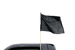 Small black flag is mounted on a car participating in a protest caravan of local activist, in Southern Lancaster County, Pennsylvania, on May 20, 2017. Activist gather on a parking lot ahead of a drive over back country roads to protest the plans of a cross lighting of a Maryland based Ku Klux Klan chapter in QuarryVille, PA.