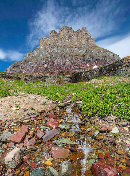 Cool mountain water dribbles down in front of Clements Mountain, in Glacier National Park.