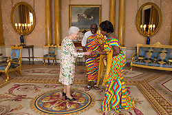 Queen Elizabeth II meets the High Commissioner of Ghana Papa Owusu-Ankomah and his wife Augustina as he presents his Letters of Credence during an audience at Buckingham Palace, London.