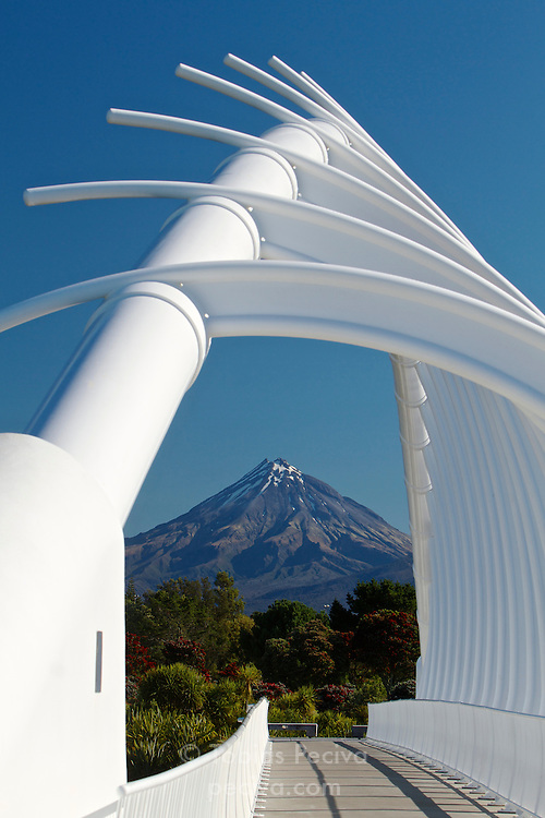 Mount Taranaki framed by the Te Rewa Rewa Bridge over the Waiwhakaiho River, in New Plymouth, New Zealand.