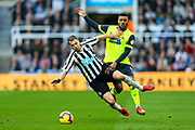 Florian Lejeune (#20) of Newcastle United is fouled by Elias Kachunga (#9) of Huddersfield Town during the Premier League match between Newcastle United and Huddersfield Town at St. James's Park, Newcastle, England on 23 February 2019.