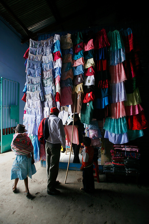 Colorful dresses worn by the indigenous population of Ayacucho, Peru (lat -13.1548°, long -74.2044°, Altitude: 9,202 Feet), and the surrounding countryside in the South-Central sierra of the Andes are on display at the mercado (main market), Wednesday morning, May 14, 2008. ?The most recent statistics on Peru's indigenous population date back to a 1993 census, according to which the country was home to just under nine million indigenous people, nearly all of whom lived in the highlands. The great majority of native people in Peru are Quechua, while around seven percent are Aymara and two percent belong to Amazon jungle groups? - (http://ipsnews.net/news.asp?idnews=35058#share).