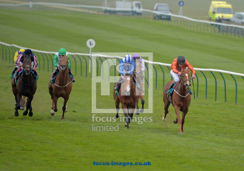 Mix and Mingle ridden by Ted Durcan (orange with black cap) wins bet365 Handicap stakes on the Thursday of the bet365 Craven Meeting at the Rowley Mile course, Newmarket<br /> Picture by Martin Lynch/Focus Images Ltd 07501333150<br /> 20/04/2017