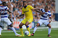 Tjarron Chery of QPR &reg;  &amp; Olamide Shodipo of QPR (l)  intercept Kyle Bartley of Leeds United. Skybet EFL championship match, Queens Park Rangers v Leeds United at Loftus Road Stadium in London on Sunday 7th August 2016.<br /> pic by John Patrick Fletcher, Andrew Orchard sports photography.