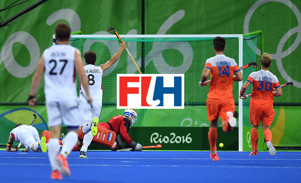 Belgium's John John Dohmen (L) scores a goal during the men's semifinal field hockey Belgium vs Netherlands match of the Rio 2016 Olympics Games at the Olympic Hockey Centre in Rio de Janeiro on August 16, 2016.  / AFP / Carl DE SOUZA        (Photo credit should read CARL DE SOUZA/AFP/Getty Images)