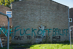 Graffiti at the Sweets Way housing estate on 23rd September 2015 in London, United Kingdom. A group of housing activists calling for better social housing provision in London occupied properties on the 142-home estate in Whetstone, in a few cases refurbishing properties intentionally destroyed by the legal owners following eviction of the original residents, in order to try to prevent the eviction of the last resident on the estate and the planned demolition and redevelopment of the entire estate by Barnet Council and Annington Property Ltd.