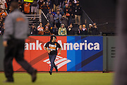 A San Francisco Giants fan runs across the field during a game against the St. Louis Cardinals at AT&T Park in San Francisco, Calif., on September 16, 2016. (Stan Olszewski/Special to S.F. Examiner)