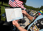 American Legion Rider Jerry Bennett of St. Cloud, Florida, shows the 2013 Legacy Ride route from Indianapolis to Houston during a stop in South Springfield on Monday, August 19, 2013. The American Legion Legacy Ride raises funds for children of active duty military members who are killed in the line of duty to go to college. (David Welker/For the News-Leader)
