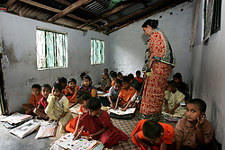 BANGLADESH CHITTAGONG 9MAR05 - Bangla class with Roxana Iqbal, a teacher who has worked at St. Athony's Free School for children from poor backgrounds in Motighorna, Pahartuli, Chittagong, Bangladesh for four years. The school was set up as a charity five years ago and provides free basic education for children from the ages of 4 to 7 years. Subjects taught include Bangla, Maths and English. ..jre/Photo by Jiri Rezac..© Jiri Rezac 2005..Contact: +44 (0) 7050 110 417.Mobile:  +44 (0) 7801 337 683.Office:  +44 (0) 20 8968 9635..Email:   jiri@jirirezac.com.Web:    www.jirirezac.com..© All images Jiri Rezac 2005 - All rights reserved.
