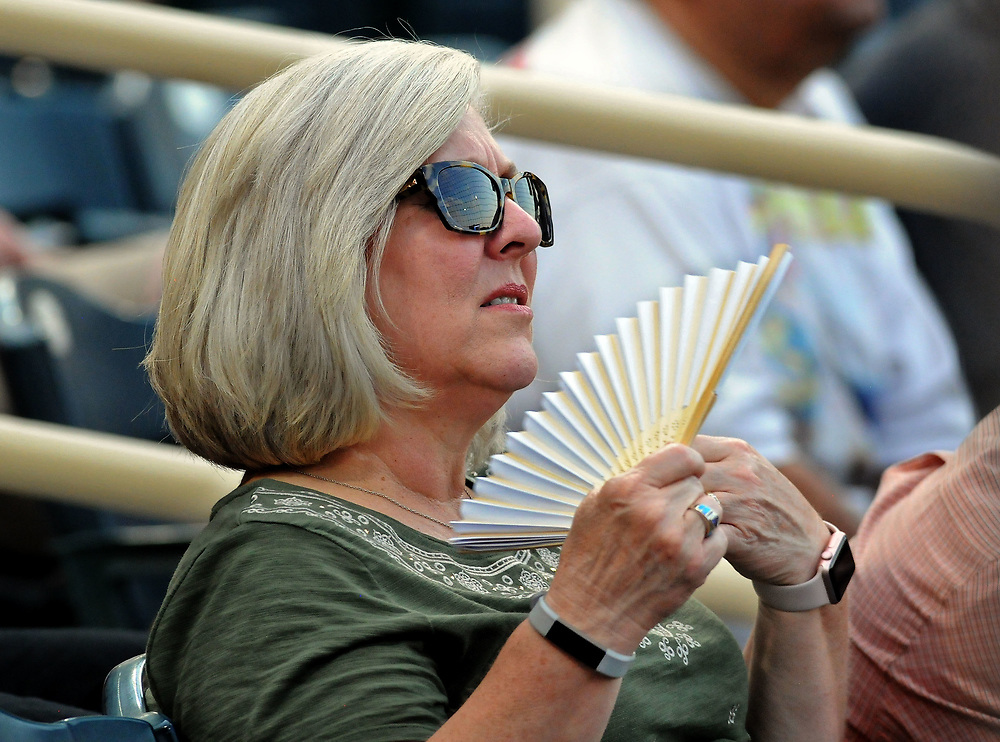 jt062217d/ sports/jim thompson/   Karen Padilla of Albuquerque tries to keep cool Thursday night as temperature was 101 at first pitch.   Thursday June. 22, 2017. (Jim Thompson/Albuquerque Journal)
