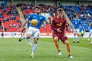Joe Shaughnessy (#5) of St Johnstone FC clears the ball ahead of James Scott (#35) of Motherwell FC during the Ladbrokes Scottish Premiership match between St Johnstone and Motherwell at McDiarmid Stadium, Perth, Scotland on 11 May 2019.