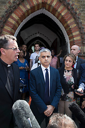 © Licensed to London News Pictures. 18/06/2017. London, UK. London Mayor Sadiq Khan stands with his wife Saadiya Khan (R) and the Reverend Robert Thompson after attending a Sunday service at St Clements church near site of the burnt out Grenfell tower block . The blaze engulfed the 27-storey building killing dozens - with 34 people still in hospital, many of whom are in critical condition. The fire brigade say that they don't expect to find anyone else alive. Photo credit: Peter Macdiarmid/LNP