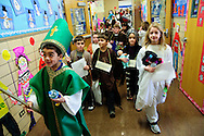 "Second grade students at St. Michael School in Orland Park portray their favorite religious figures during the school's annual Parade of Saints, February 2. During the event, costumed students stand motionless in the school commons for parents, grandparents and friends to ""activate"" the Saint, who will offer a brief historical description. The session is followed by a parade through the school. Brian J. Morowczynski/ViaPhotos."