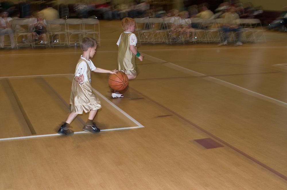 young boys play in a church league basketball game, Richmond, VA, USA