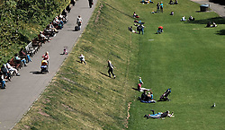 Edinburgh Weather, Wednesday 3rd May 2017<br />  <br /> Tourists and locals enjoy the sunshine in Princes Street Gardens, Edinburgh today<br /> <br /> (c) Alex Todd | Edinburgh Elite media