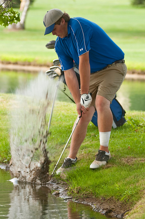 Jordan Gerhart hits his ball out of the water on hole 6 at the Twin Lakes Golf Course on Wednesday. Gerhart was participating in the final round of the Richland County Junior Golf Tournament.