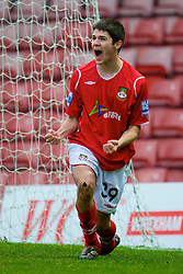 WREXHAM, WALES - Saturday, February 14, 2009: Wrexham's Ryan Flynn, on loan from Liverpool, celebrates scoring the second goal against Grays Athletic during the Blue Square Premier League match at the Racecourse Ground. (Mandatory credit: David Rawcliffe/Propaganda)