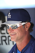 LOS ANGELES, CA - JUNE 15:  Manager Don Mattingly #8 of the Los Angeles Dodgers smiles as he talks to the media in the dugout before the game against the Arizona Diamondbacks at Dodger Stadium on Sunday, June 15, 2014 in Los Angeles, California. The Diamondbacks won the game 6-3. (Photo by Paul Spinelli/MLB Photos via Getty Images) *** Local Caption *** Don Mattingly