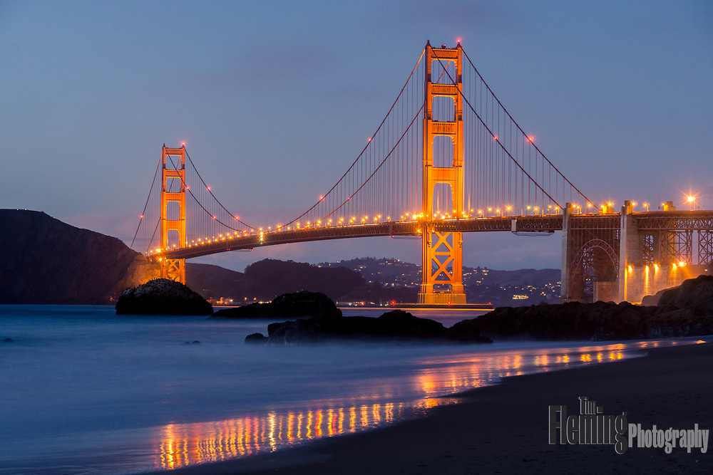 The lights come on at dusk on the Golden Gate Bridge, San Francisco, California