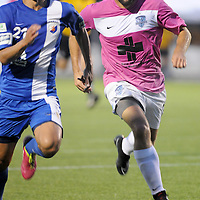 Wilmington's Paul Nicholson chases down a loose ball with Dayton's Shintaro Harada Saturday August 9, 2014 at Legion Stadium in Wilmington, N.C. (Jason A. Frizzelle)