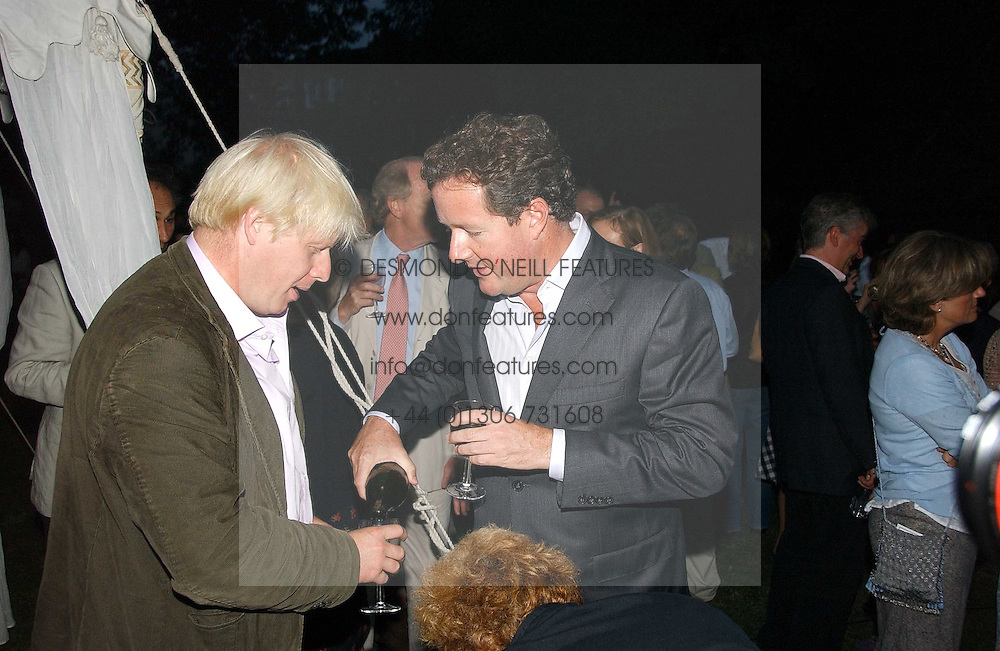 Left to right, BORIS JOHNSON MP and PIERS MORGAN at a party to celebrate the publication of Notting Hell by Rachel Johnson held in the gardens of 1 Rosmead Road, London W11 on 4th September 2006.<br />