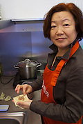 "Vienna, Austria. Kiang Winebar.<br /> Li Chen Kiang making ""Gekochte Wuntun/Chili-Sesamöl Marinade (Cooked Wuntun marinated with Chili and Sesame Oil)""."