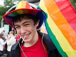 © Licensed to London News Pictures. <br /> 27/09/2014. <br /> <br /> Middlesbrough, United Kingdom<br /> <br /> A young man reacts to the camera during a parade in the centre of Middlesbrough that was part of a Pride event that brings together many members of the Lesbian, Gay, Bisexual and Transgender community from the area.<br /> <br /> Photo credit : Ian Forsyth/LNP