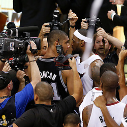 Jun 20, 2013; Miami, FL, USA; Miami Heat small forward LeBron James (6) embraces San Antonio Spurs power forward Tim Duncan (21) after game seven in the 2013 NBA Finals at American Airlines Arena. Miami defeated San Antonio 95-88 to win the NBA Championship. Mandatory Credit: Derick E. Hingle-USA TODAY Sports