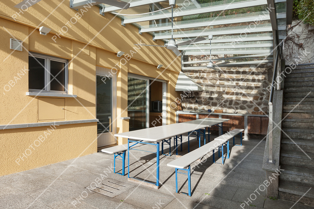 architecture, veranda with table and benchs, outside