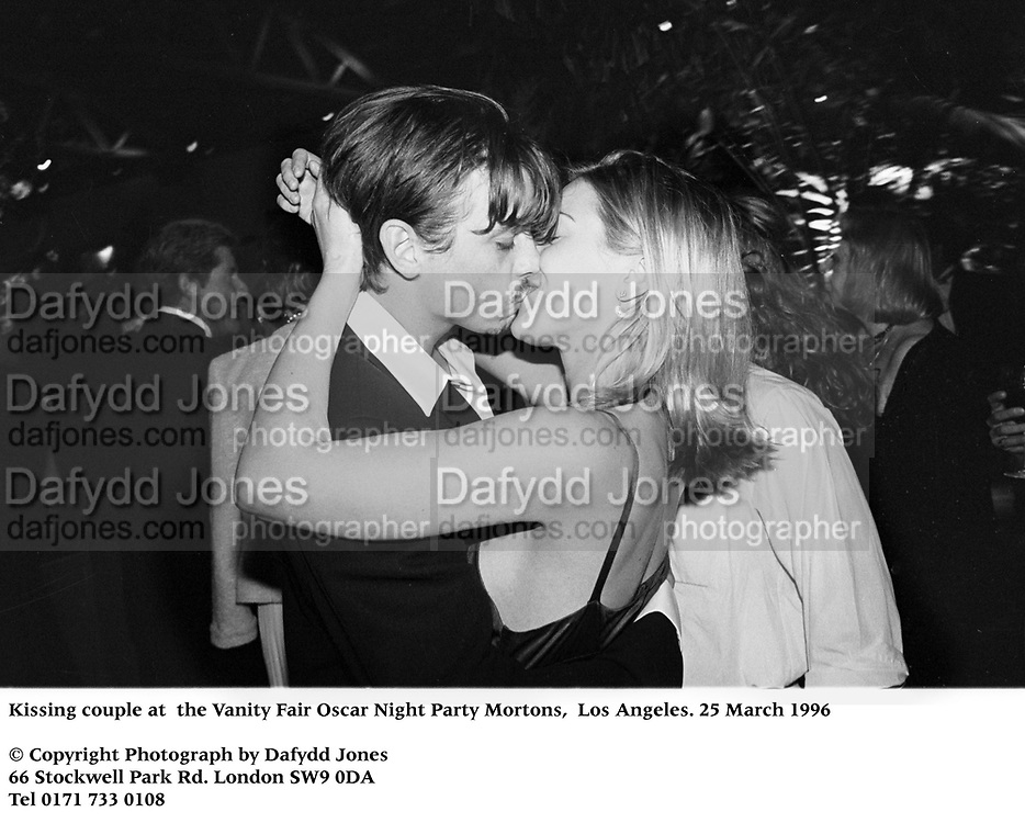Kissing couple at  the Vanity Fair Oscar Night Party Mortons,  Los Angeles. 25 March 1996<br /> <br /> © Copyright Photograph by Dafydd Jones<br /> 66 Stockwell Park Rd. London SW9 0DA<br /> Tel 0171 733 0108