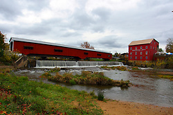 24 October 2017:  The Bridgeton Mill and Covered Bridge.  Water from a recent rain saturates the falls under the bridge as fall colored trees are in abundance.<br /> <br />  Parke County Indiana is the site of the Indiana Covered Bridge Festival every October