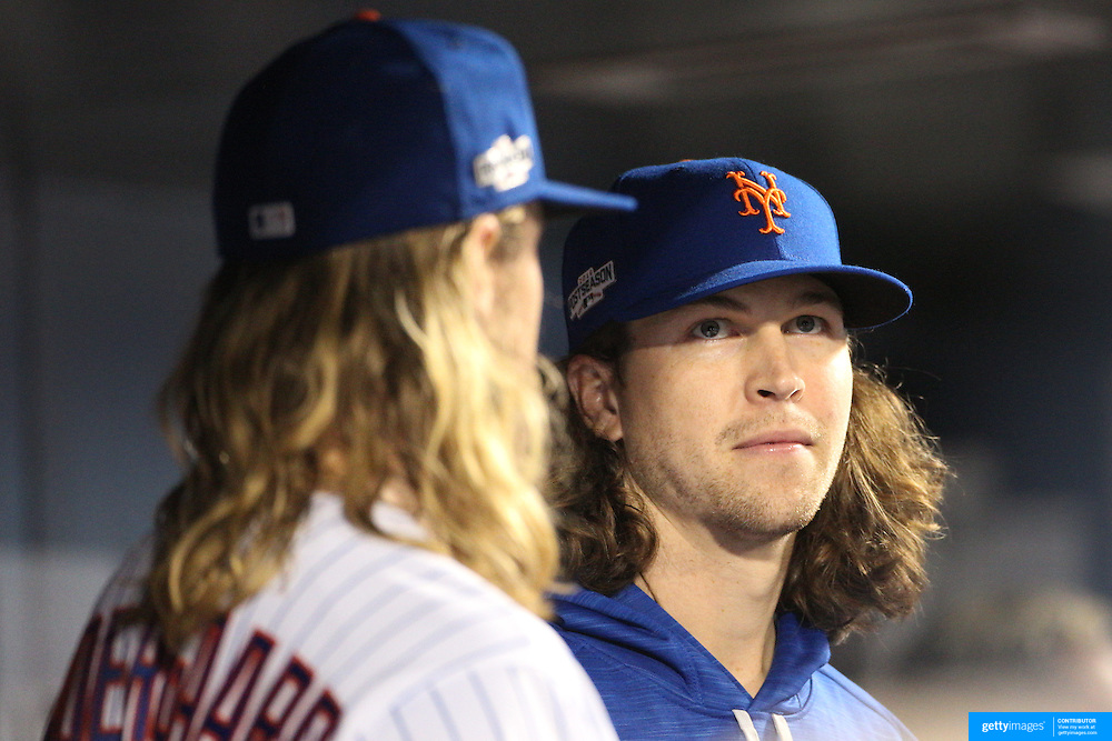NEW YORK, NEW YORK - October 5: Pitcher Noah Syndergaard #34 and Jacob deGrom #48 of the New York Mets during the San Francisco Giants Vs New York Mets National League Wild Card game at Citi Field on October 5, 2016 in New York City. (Photo by Tim Clayton/Corbis via Getty Images)