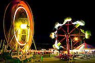 The rides at the Elmwood, IL Fall Festival are spinning fast as the carnival gets underway.