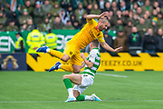 Ryan Christie (#17) of Celtic FC tackles Scott Robinson (#17) of Livingston FC and earns a red card during the Ladbrokes Scottish Premiership match between Livingston FC and Celtic FC at The Tony Macaroni Arena, Livingston, Scotland on 6 October 2019.