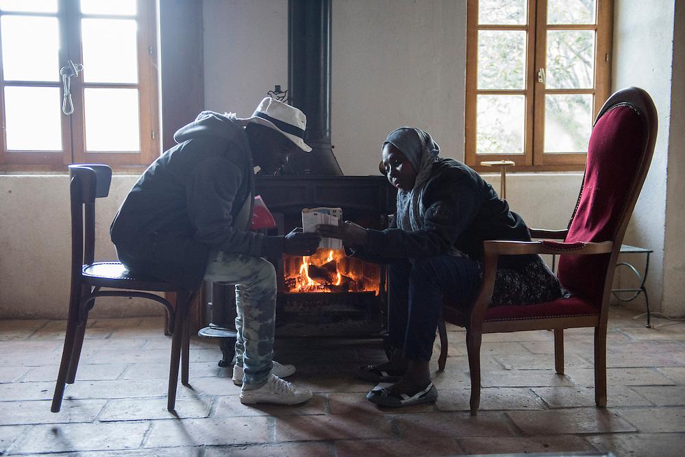 November 7, 2016 - Breil-sur-Roya, France: Refugees from Sudan study French in Francoise Cotta's house where they found shelter. Cotta is a lawyer and a member of a clandestine network that helps migrants who walked into the valley from Ventimiglia, Italy, with shelter, food and transportation.<br /> <br /> 7 novembre 2016 - Breil-sur-Roya, France: Les r&eacute;fugi&eacute;s soudanais &eacute;tudient le fran&ccedil;ais dans la maison de Fran&ccedil;oise Cotta o&ugrave; ils ont trouv&eacute; refuge. Cotta est avocate et membre d'un r&eacute;seau qui aide les migrants qui sont entr&eacute;s dans la vall&eacute;e de la Roya depuis Vintimille.