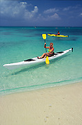 Commercial advertising image of kayaking on Seven Mile Beach for Cobra Kayaks brochure, shot on film