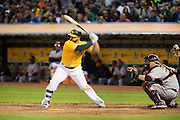 Oakland Athletics first baseman Yonder Alonso (17) swings at a pitch against the Baltimore Orioles at Oakland Coliseum in Oakland, Calif. on August 8, 2016. (Stan Olszewski/Special to S.F. Examiner)