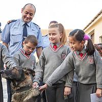 Students from Ennis National school with Superintendant Derek Smart and Gardai dog Brew