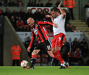 Kevin Ellison and Simon Walton battle during the Sky Bet League 2 match between Morecambe and Crawley Town at the Globe Arena, Morecambe, England on 20 October 2015.