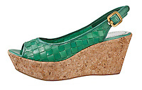 Green woven leather and cork wedge shoe on white background