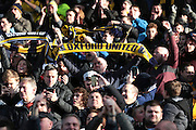 Oxford United fans celebrate their win in the The FA Cup third round match between Oxford United and Swansea City at the Kassam Stadium, Oxford, England on 10 January 2016. Photo by Jemma Phillips.