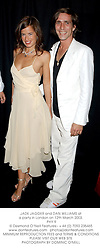 JADE JAGGER and DAN WILLIAMS at a party in London on 12th March 2003.<br />PHY 9