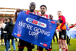 John Akinde and Bruno Andrade of Lincoln City celebrate winning promotion from Sky Bet League Two to Sky Bet League One - Mandatory by-line: Robbie Stephenson/JMP - 13/04/2019 - FOOTBALL - Sincil Bank Stadium - Lincoln, England - Lincoln City v Cheltenham Town - Sky Bet League Two